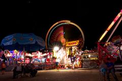 Fair carnival ferry wheel in speed Royalty Free Stock Photos