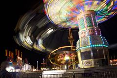 Fair carnival ferry wheel in speed Royalty Free Stock Images