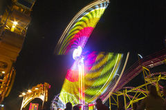 Fair carnival half wheel in motion Royalty Free Stock Image