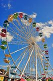 Fair Day. Ferris wheel against the big blue sky Stock Images