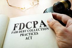 Fair Debt Collection Practices Act FDCPA on a table. Fair Debt Collection Practices Act FDCPA  and gavel on a table Royalty Free Stock Photography