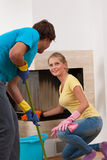 Fair division of labor. In home, young couple Royalty Free Stock Photo