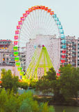 Fair Ferris wheel adorned with lights Stock Photos