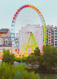 Fair Ferris wheel adorned with lights Stock Images
