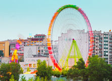 Fair Ferris wheel adorned with lights Stock Photography