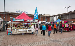 Fair in Finland, people walk between the stalls Stock Photos