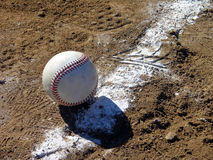 Fair Or Foul. It depends upon your point of view. This baseball is foul if it's the 3rd base line. It's fair if it's the 1st base line Stock Photo