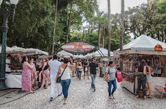 Fair at General Osorio square. Curitiba - PR, Brazil - December 15, 2018: Shops selling food and crafts at open air fair at Feira da Praca General Osorio. Local stock photo