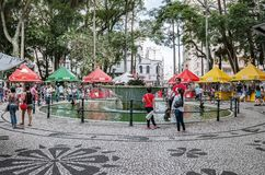 Fair at General Osorio square. Curitiba - PR, Brazil - December 15, 2018: Shops selling food and crafts at open air fair at Feira da Praca General Osorio. Local stock images