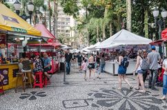 Fair at General Osorio square. Curitiba - PR, Brazil - December 15, 2018: Shops selling food and crafts at open air fair at Feira da Praca General Osorio. Local royalty free stock photos