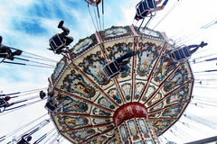 Fairgoers being spun around on a swinging and tilting fair ride Royalty Free Stock Photos