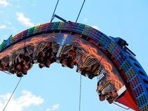 Fair Goers On Exciting Ride Royalty Free Stock Photos