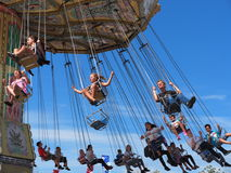 Fair Goers On Exciting Ride Stock Photography