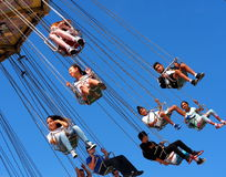 Fair Goers On Exciting Ride Royalty Free Stock Images