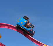 Fair Goers On Exciting Ride Stock Image