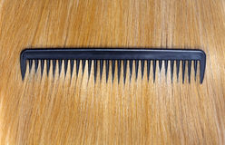 Fair hair and comb Royalty Free Stock Images