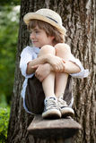 Fair-haired boy in sneakers Stock Image
