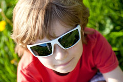 The fair-haired boy in sunglasses Stock Photography