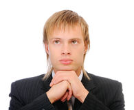 Fair-haired businessman reflects on problems Royalty Free Stock Photography