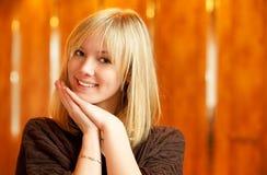Fair-haired girl smiles Stock Photography