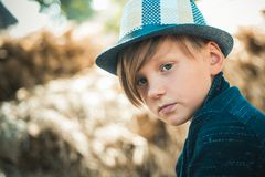 Fair-haired Kid Playing With Leaves And Looking At Camera. Sale For Entire Autumn Collection, Incredible Discounts And Royalty Free Stock Image