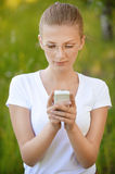 Fair-haired woman looking at phone Royalty Free Stock Photo