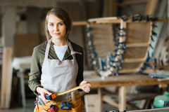 Fair-haired woodworker with tape measure Stock Images