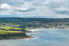 Landscape of city of Ballycastle from Fair head trail in Northern Ireland, United Kingdom. Fair head trail is one of the famous attraction in country of antrim royalty free stock photo