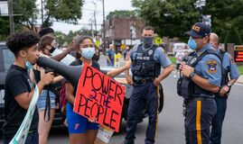 Fair Lawn Black Lives Matter Protest in response to Pro-Police Rally - Police officers standing in front of BLM Protesters - Power