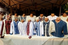 Fair in Odessa. Showcase with Ukrainian embroidered shirts. Fair in Odessa. Showcase with Ukrainian embroidered. National clothes stock photo