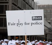 Fair pay for police Royalty Free Stock Photography