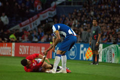 Fair Play. Lucho Gonzales (F.C.Porto (POR)) helps Cristiano Ronaldo (Manchester United (ENG)) getting up in a Fair Play noble action when playing to qualify for Stock Photo