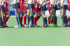 Fair Play. Concept for sportsmanship, showing two oppsing teams of women field hockey players shaking hands after the line-up of an important match Royalty Free Stock Photo