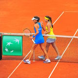 Fair play - Sorana Cirstea and Ana Ivanovic. Sorana Cirstea (winner) and Ana Ivanovic at the end of the first game between Romania and Serbia women tennis teams Stock Photo
