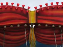 Fair with red carousel and lamps. A fair with red and yellow carousel and lamps and chains Stock Image