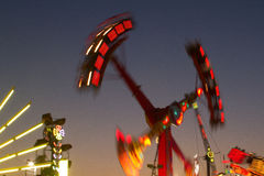 Fair Rides at Dusk Stock Photo