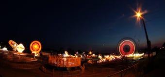 Fair rides at night. Rides at as small country fair as seen at night stock photography