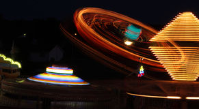 Fair rides at night Royalty Free Stock Photos