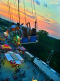 Fair rides. Swings at fair with sunset Royalty Free Stock Photography