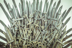 Fair, royal throne made of iron swords, seat of the king, symbol Royalty Free Stock Image