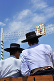 Fair of Seville, two men with hat on a horse carriage Stock Image