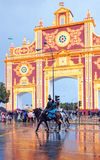 Fair in Seville under the rain, Andalusia, Spain. Monumental entrance to the Seville Fair, named Portada de Feria, rainy day and stormy afternoon, Andalusia Stock Photos