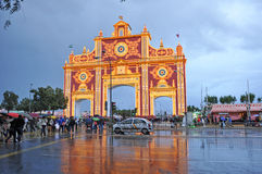 Fair in Seville under the rain, Andalusia, Spain. Monumental entrance to the Seville Fair, named Portada de Feria, rainy day and stormy afternoon, Andalusia Royalty Free Stock Images