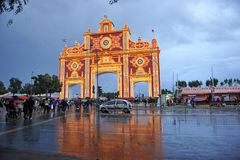 Fair in Seville under the storm, Andalusia, Spain. Monumental entrance to the Seville Fair, named Portada de Feria, rainy day and stormy afternoon, Andalusia Stock Photos
