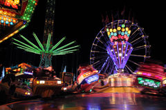 Fair with spinning rides Stock Image