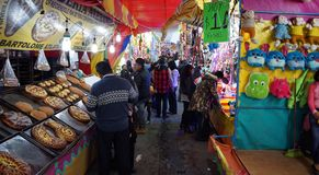 Fair in Toluca mexico. People walking and shopping in a traditional mexican fair in toluca state of mexico, tents with some food and toys to sell, traditional stock photos