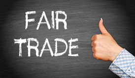 Fair Trade with thumb up Royalty Free Stock Photos