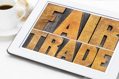 Fair trade word abstract on tablet Stock Photo