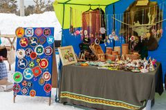 The fair of traditional souvenirs and charms of the peoples of the Far North is fur and birch bark royalty free stock photos