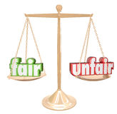 Fair Vs Unfair Words Scale Balance Justice Injustice. Fair Vs Unfair words on a gold scale or balance to illustrate and compare justice and injustice in legal or Royalty Free Stock Image